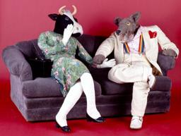 "Stuffed (coyote) wolf is dressed as a man in a white suit, nicknamed Ray. ""Mrs. Cow"" is a human-sized stuffed cow wearing a red print dress, nicknamed ""Elsie""."